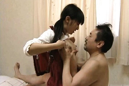 Pretty Asian schoolgirl gets banged by an older guy.