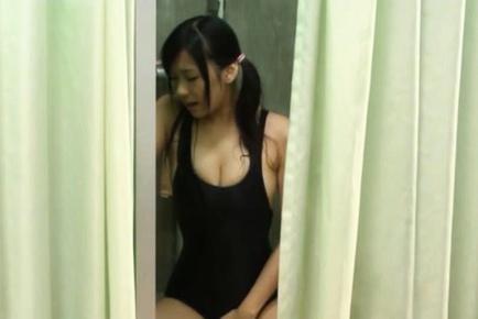 Busty girl Nana Ogura fucks and sucks wearing a swimsuit.
